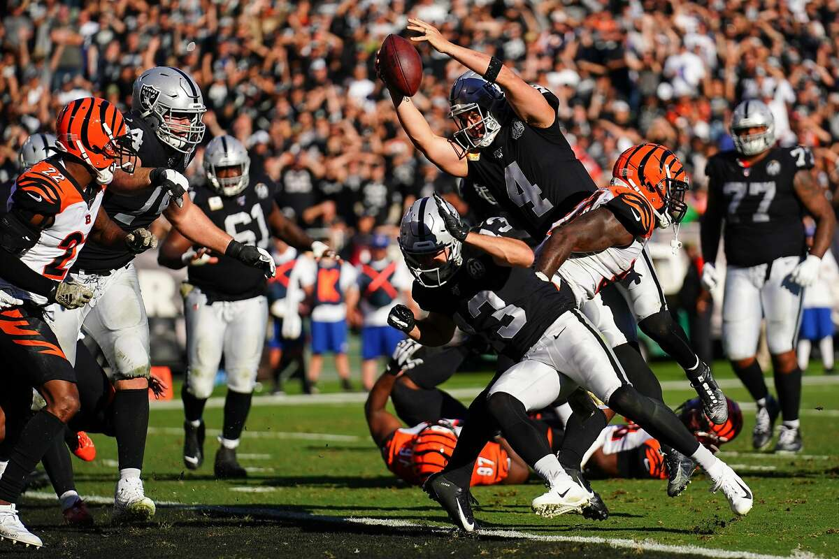 OAKLAND, CALIFORNIA - NOVEMBER 17: Derek Carr #4 of the Oakland Raiders dives into the end zone for a touchdown during the first half against the Cincinnati Bengals at RingCentral Coliseum on November 17, 2019 in Oakland, California.