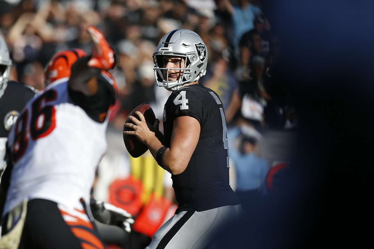 Oakland Raiders quarterback Derek Carr looks to throw during the first half of an NFL football game against the Cincinnati Bengals in Oakland, Calif., Sunday, Nov. 17, 2019.