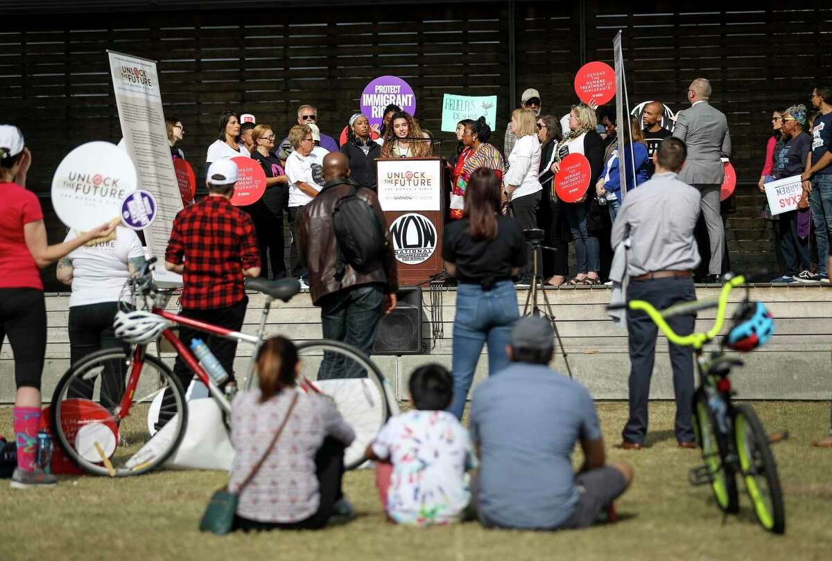 A couple dozen organizers and spectators attended a rally to bring attention to women and girls in immigration detention facilities, on Sunday, Nov. 17, 2019, in Houston. The National Organization for Women, working in collaboration with other groups, hosted the rally.