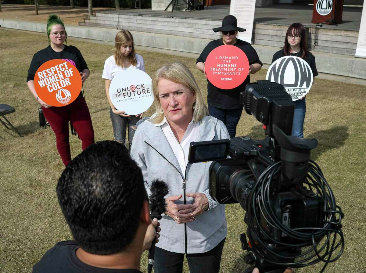 U.S. Rep. Sylvia Garcia speaks to a television reporter before a rally to bring attention to women and girls in immigration detention facilities, on Sunday, Nov. 17, 2019, in Houston. A couple dozen organizers and spectators attended the rally near downtown. The National Organization for Women, working in collaboration with other groups, hosted it.