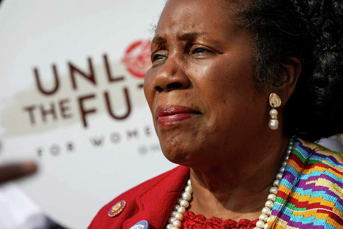 U.S. Rep. Sheila Jackson Lee speaks to a videographer for an advocacy group before a rally to bring attention to women and girls in immigration detention facilities, on Sunday, Nov. 17, 2019, in Houston. A couple dozen organizers and spectators attended the rally near downtown. The National Organization for Women, working in collaboration with other groups, hosted it.