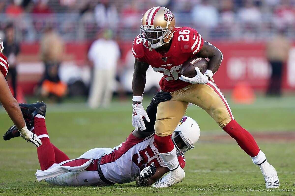 Running back Tevin Coleman #26 of the San Francisco 49ers rushes the football past linebacker Chandler Jones #55 of the Arizona Cardinals during the second half of the NFL game at Levi's Stadium on November 17, 2019 in Santa Clara, California.