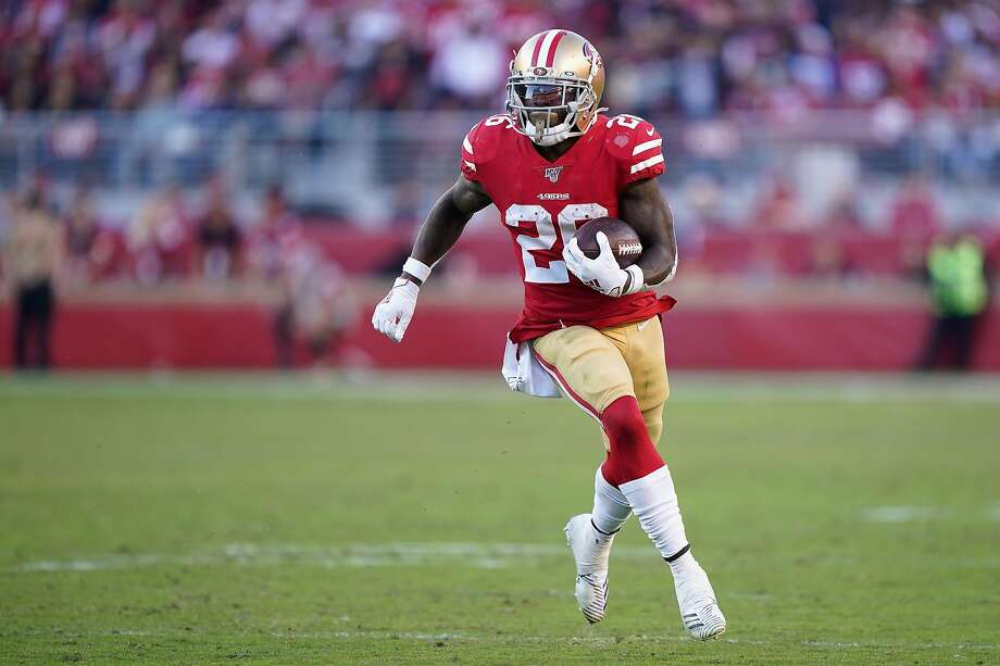 Running back Tevin Coleman #26 of the San Francisco 49ers rushes the football against the Arizona Cardinals during the second half of the NFL game at Levi's Stadium on November 17, 2019 in Santa Clara, California. (Photo by Thearon W. Henderson/Getty Images) Photo: Thearon W. Henderson, Getty Images