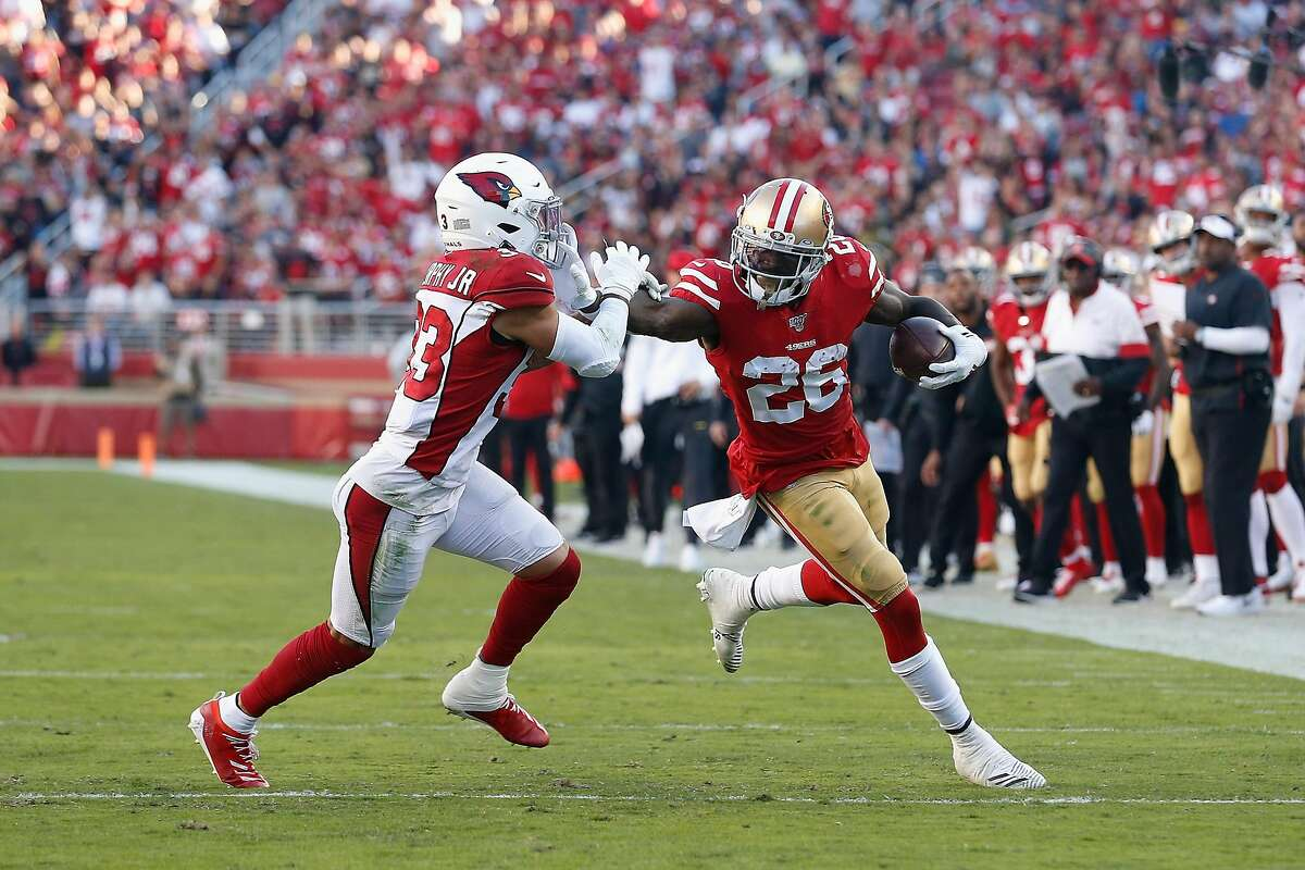 Running back Tevin Coleman #26 of the San Francisco 49ers runs with the football against cornerback Byron Murphy Jr. #33 of the Arizona Cardinals during the second half of the NFL game at Levi's Stadium on November 17, 2019 in Santa Clara, California. (Photo by Lachlan Cunningham/Getty Images)