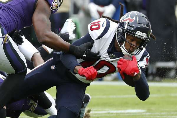 Houston Texans wide receiver DeAndre Hopkins (10) is brought down by Baltimore Ravens middle linebacker Josh Bynes (57) after making a first down reception during the first quarter of an NFL football game at M&T Bank Stadium on Sunday, Nov. 17, 2019, in Baltimore.