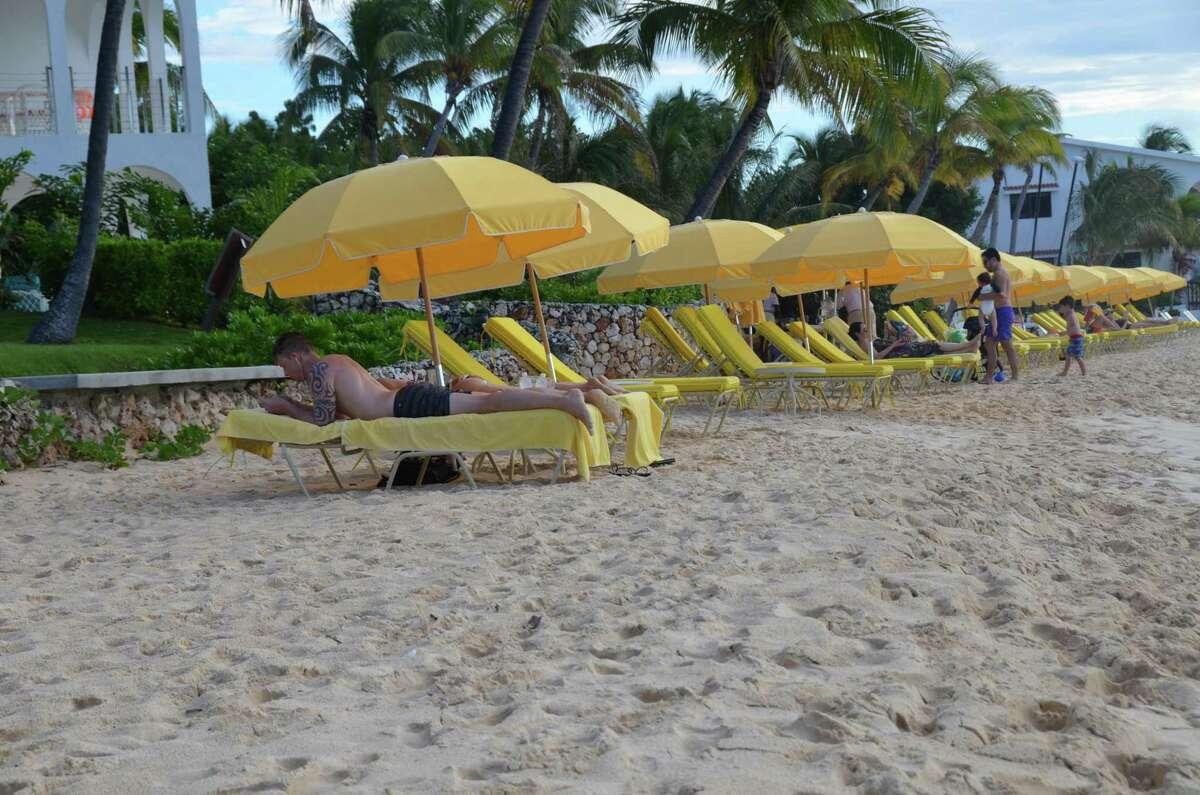 Tourists enjoy the beach on the Caribbean island of Anguilla on Sunday.