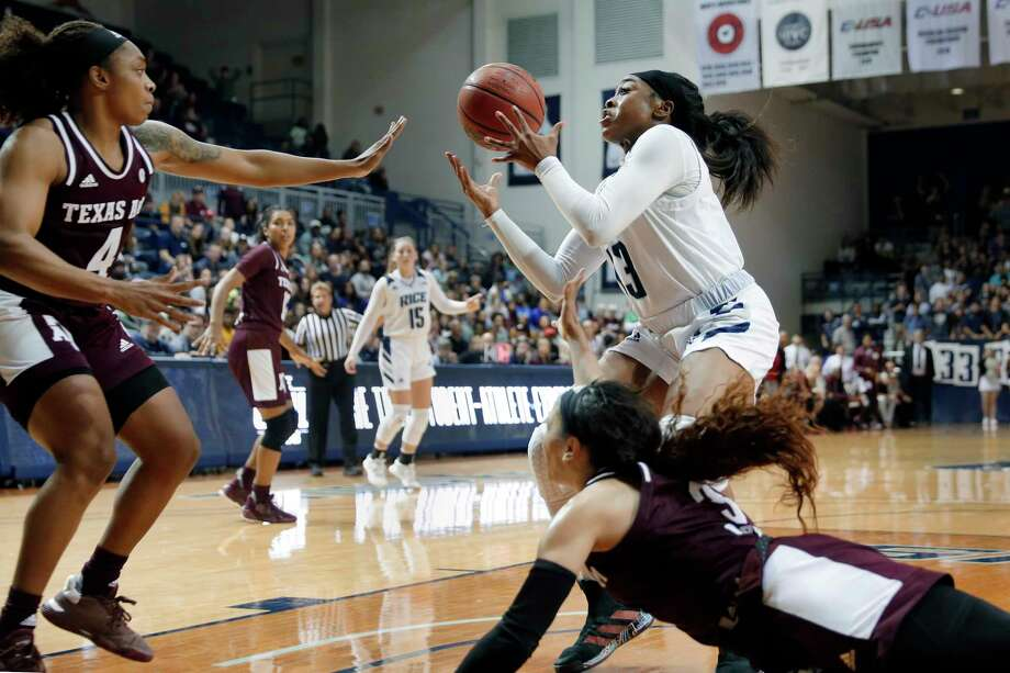 Rice guard Erica Ogwumike, top right, bobbles the ball after an attempted steal by Texas A&M guard Chennedy Carter, bottom, as Texas A&M guard Shambria Washington (4) reaches in during the second half of an NCAA college basketball game Sunday, Nov. 17, 2019, in Houston. (AP Photo/Michael Wyke) Photo: Michael Wyke, Associated Press / Copyright 2019 The Associated Press. All rights reserved.