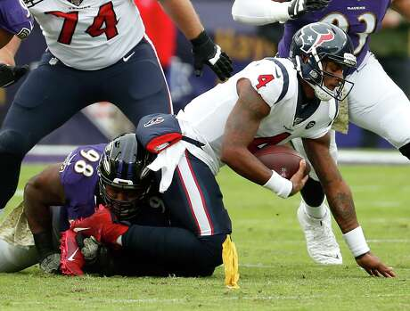 Deshaun Watson, taking his first sack of the game against the Ravens who got to him six times overall.