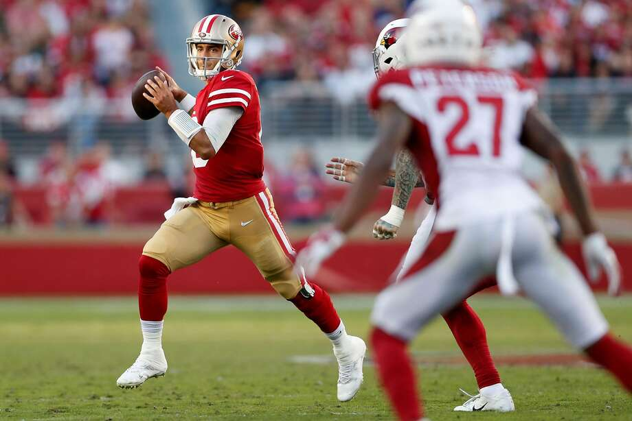 San Francisco 49ers' Jimmy Garoppolo looks to pass in 4th quarter of Niners' 36-26 win over Arizona Cardinals in NFL game at Levi's Stadium in Santa Clara, Calif., on Sunday, November 17, 2019. Photo: Scott Strazzante / The Chronicle