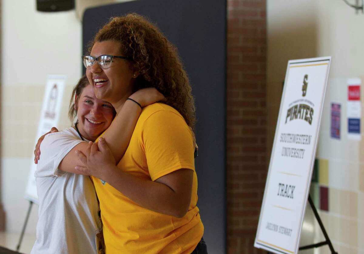 In this 2018 file photo, Jaelynn Stewart, right, gets a hug from Rachel Irby before a college signing ceremony at Porter High School. Several New Caney ISD middle and high schools, including Porter, showed continued growth under the new Children At Risk academic rankings.