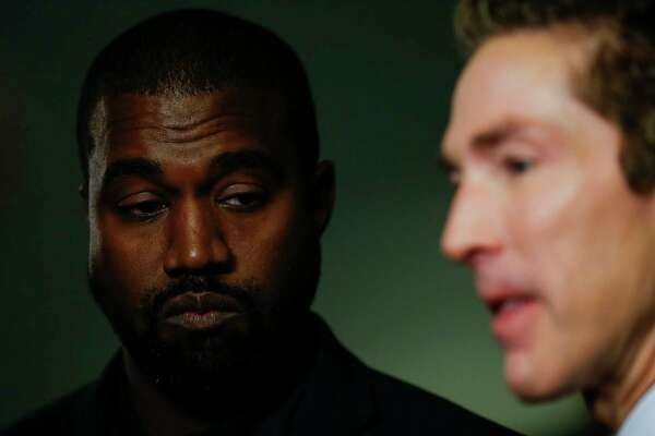 Kanye West and senior pastor Joel Osteen talk to reporters after the morning service at Lakewood Church Sunday, Nov. 17, 2019, in Houston. West joined Osteen on stage to talk about overcoming adversity and his faith journey.