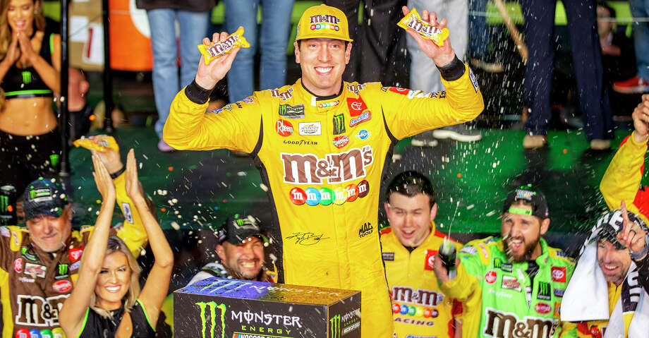 Kyle Busch (18) reacts after winning the Homestead-Miami Speedway NASCAR 21st Annual Ford EcoBoost 400 Monster Energy Series on Sunday, Nov. 17, 2019 in Homestead, Fla. (Daniel A. Varela/Miami Herald/TNS) Photo: Daniel A. Varela/TNS