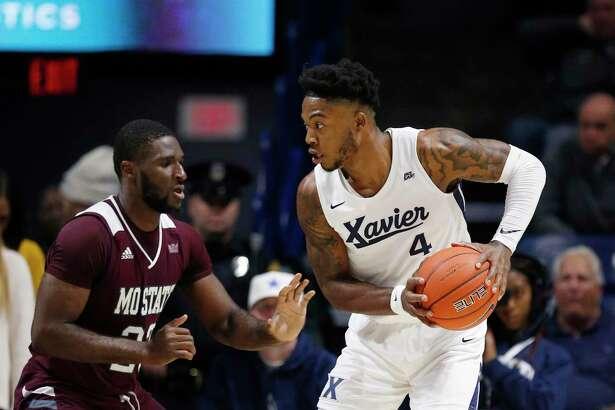 Xavier forward Tyrique Jones, right, is pressured by Missouri State forward Kabir Mohammed on Friday.