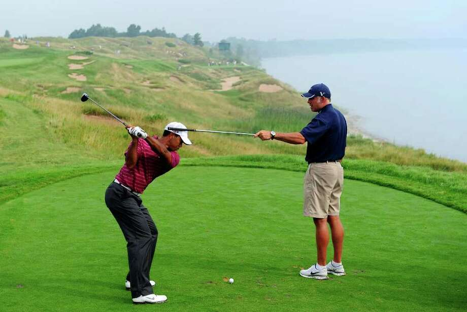 KOHLER, WI - AUGUST 10:  Tiger Woods works on his golf swing with his caddie Steve Williams (R) during a practice round prior to the start of the 92nd PGA Championship on the Straits Course at Whistling Straits on August 10, 2010 in Kohler, Wisconsin.  (Photo by Stuart Franklin/Getty Images) *** Local Caption *** Tiger Woods;Steve Williams Photo: Stuart Franklin, Getty Images / 2010 Getty Images