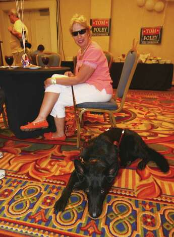 Andree Pesci, of Vernon, sits with her guide dog Titan, while at Foley's primary day party at the Mariott Hotel in Rocky Hill, Conn. on Tuesday August 10, 2010. Photo: Christian Abraham / Connecticut Post