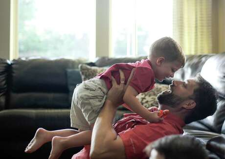 Tim Timmerman plays with his youngest son, Tristan, in their Cinco Ranch, Texas home on Tuesday, June 18, 2019.
