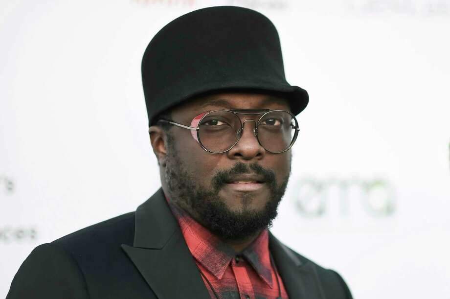 Qantas supports flight attendant after will.i.am calls her a racist on Twitter