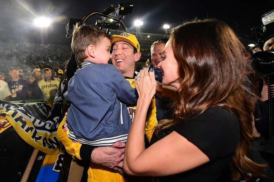 Kyle Busch, driver of the No. 18 M&Ms Toyota, celebrates with his wife, Samantha, and their son, Brexton, after winning the NASCAR Cup Series Championship at Homestead Speedway in Florida. Photo: Jared C. Tilton / Getty Images
