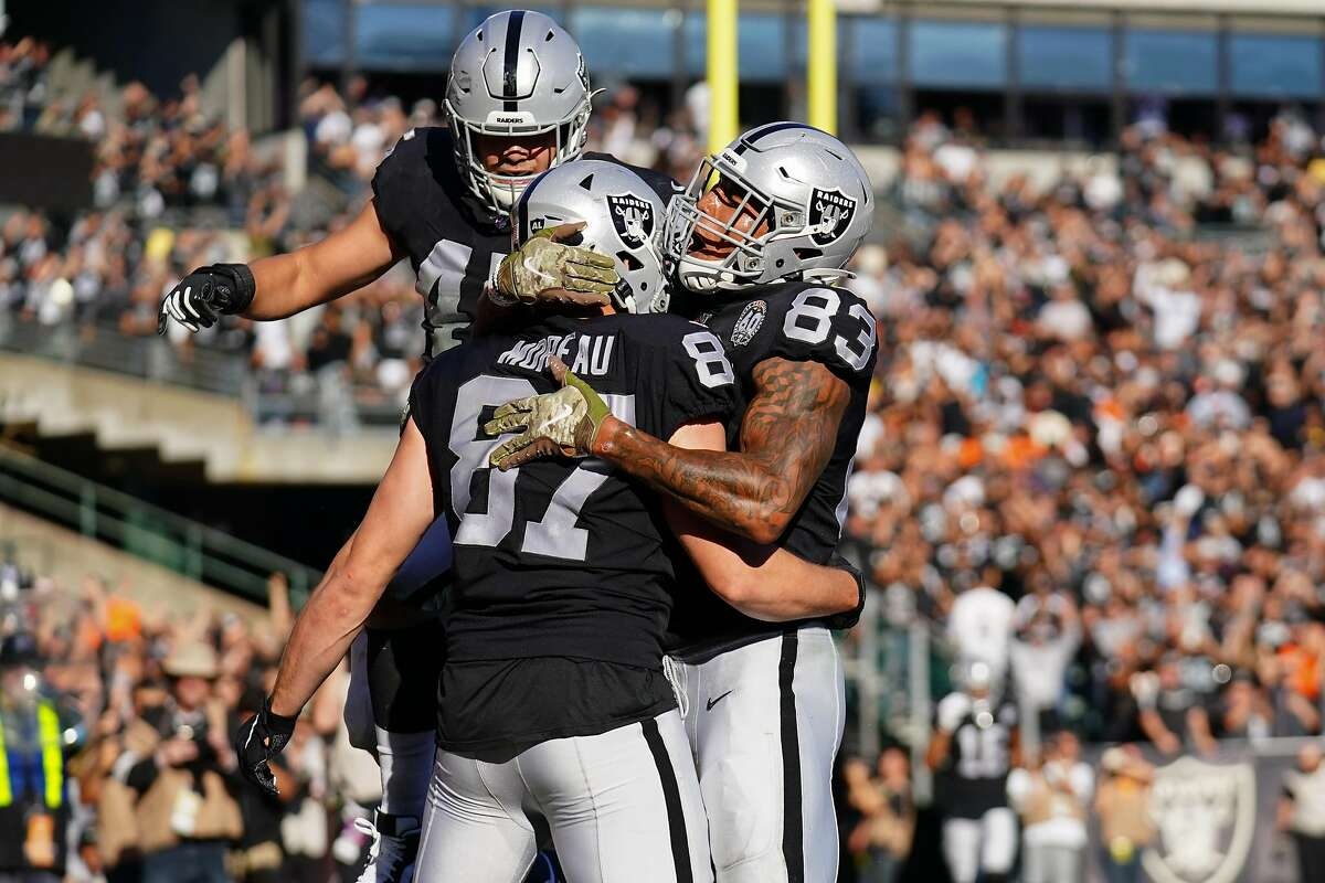 OAKLAND, CALIFORNIA - NOVEMBER 17: Foster Moreau #87 celebrates catching a touchdown pass with Darren Waller #83 of the Oakland Raiders during the first half against the Cincinnati Bengals at RingCentral Coliseum on November 17, 2019 in Oakland, California. (Photo by Daniel Shirey/Getty Images)
