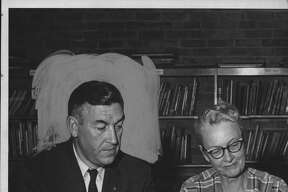 Guilderland schools Superintendent Alton Farnsworth meets with Dorothy Clark on Nov. 10, 1960. In November 1969, he announced he was resigning the following year. (Times Union Archive)