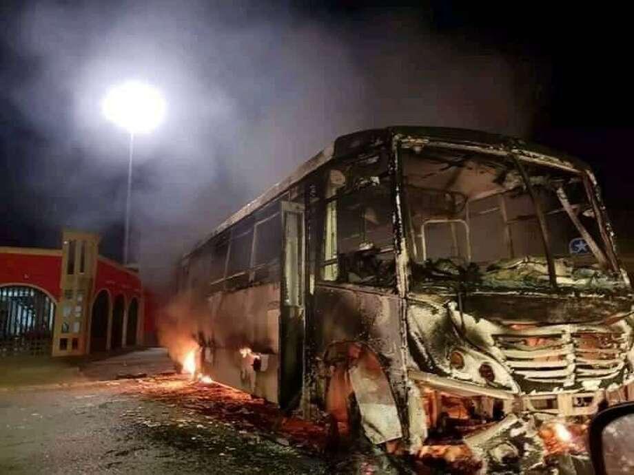 Burning vehicles were used to block main roads Friday during attacks in Nuevo Laredo. Photo: Courtesy Photo