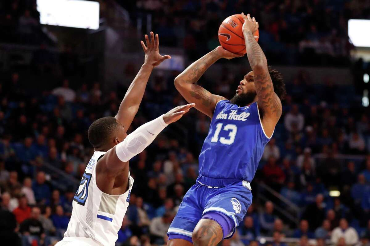 Seton Hall's Myles Powell (13) shoots over Saint Louis' Fred Thatch Jr. (20) during the first half of an NCAA college basketball game Sunday, Nov. 17, 2019, in St. Louis. (AP Photo/Jeff Roberson)