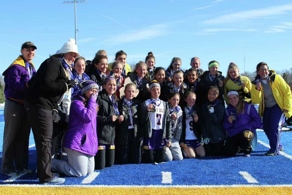 Members of the Johnstown field hockey program pose with their runner-up medals Sunday after falling 1-0 to Bronxville in the Class C state championship game at Alden High School. (Mike Pesarchick/ Special to the Times Union)