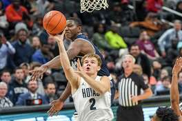 Georgetown guard Mac McClung drives to the basket against Mount St. Mary's forward Malik Jefferson at Capital One Arena in Washington on Sunday, Nov. 17, 2019.