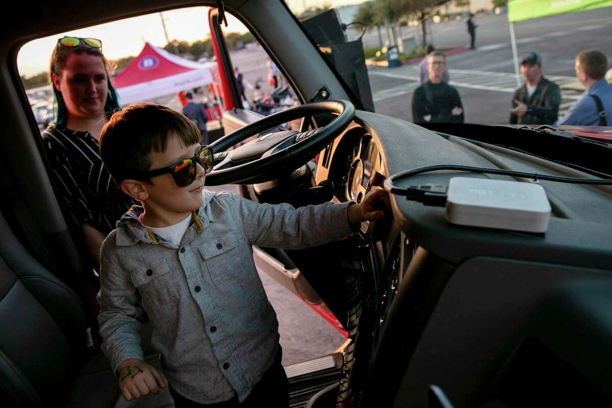 Ari Gold, 5, explores the buttons in the front seat of an autonomous Kodiak Robotics truck during the fourth annual Texas Mobility Summit kickoff Sunday at the Freeman Coliseum.