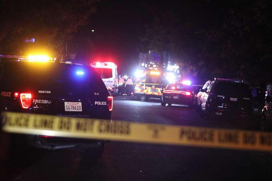 "Police and emergency vehicles are on the scene Sunday, Nov. 17, 2019, of a mass shooting in southeast Fresno, Calif. At least nine people are reported to have been shot, and police said ""several individuals""� were killed. (Larry Valenzuela/Fresno Bee/TNS) Photo: Larry Valenzuela / TNS"