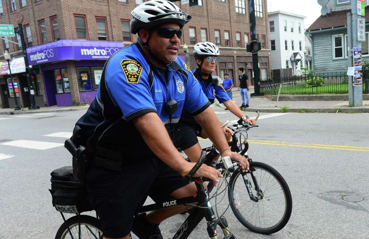 Norwalk police officer Hector Delgado on patrol as part of the department's bicycle unit in 2016.