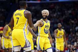 Golden State Warriors guard Ky Bowman (12) and Golden State Warriors forward Eric Paschall (7) in the second half of an NBA basketball game in New Orleans, Sunday, Nov. 17, 2019. The Pelicans won 108-100. (AP Photo/Tyler Kaufman)