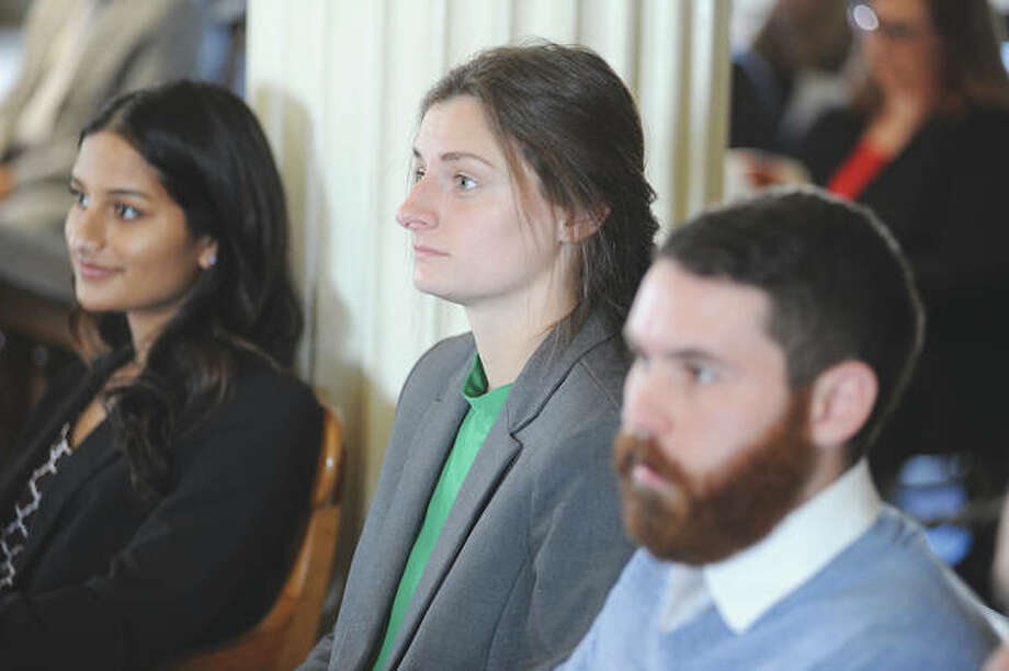 Illinois College student Charlotte Crofton (center) takes part in a weekend ceremony for Student Laureates. Photo: David Blanchette | Journal-Courier