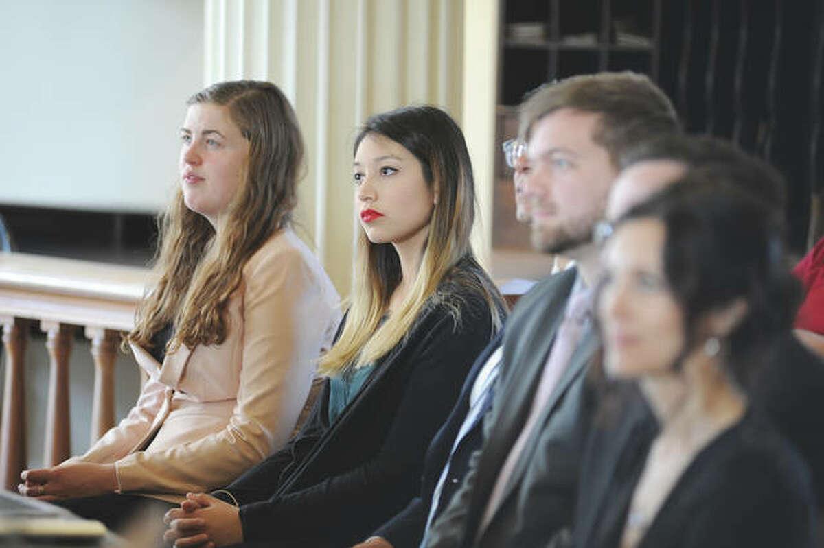 MacMurray College senior Georgia Suau (center) listens during a ceremony with fellow Student Laureates.