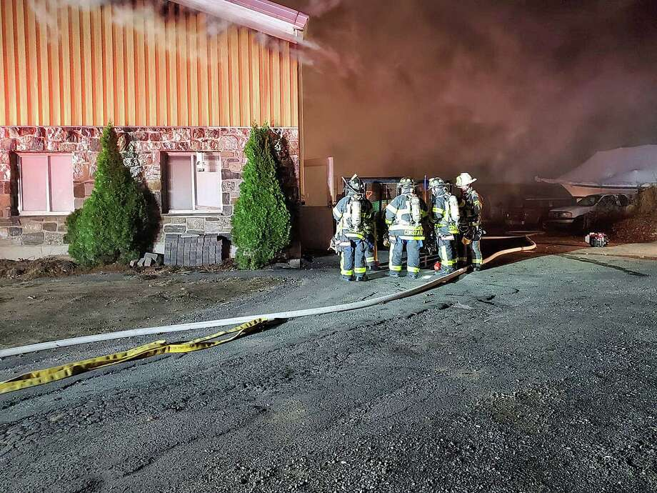 Firefighters battled an early morning blaze at a commercial building on Saw Mill Road, according to the New Fairfield Volunter Fire Department Photo: Fairfield County Fire And EMS Photo