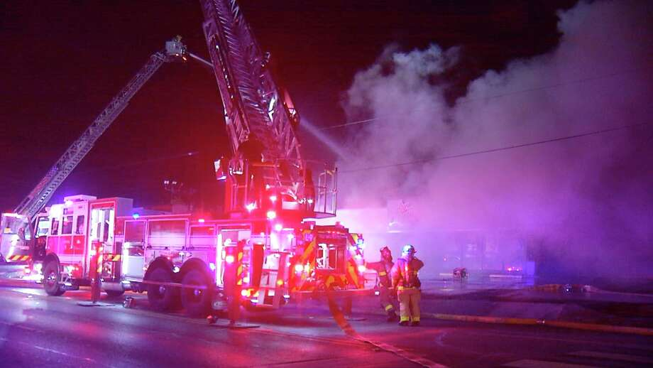 SAFD battled an early morning blaze that destroyed one of the original Church's Chicken restaurants. Photo: Ken Branca