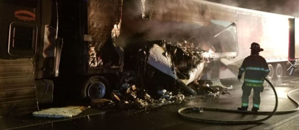 Northbound I-5 in Lakewood closed after crash involving burning tractor-trailer, fleeing driver