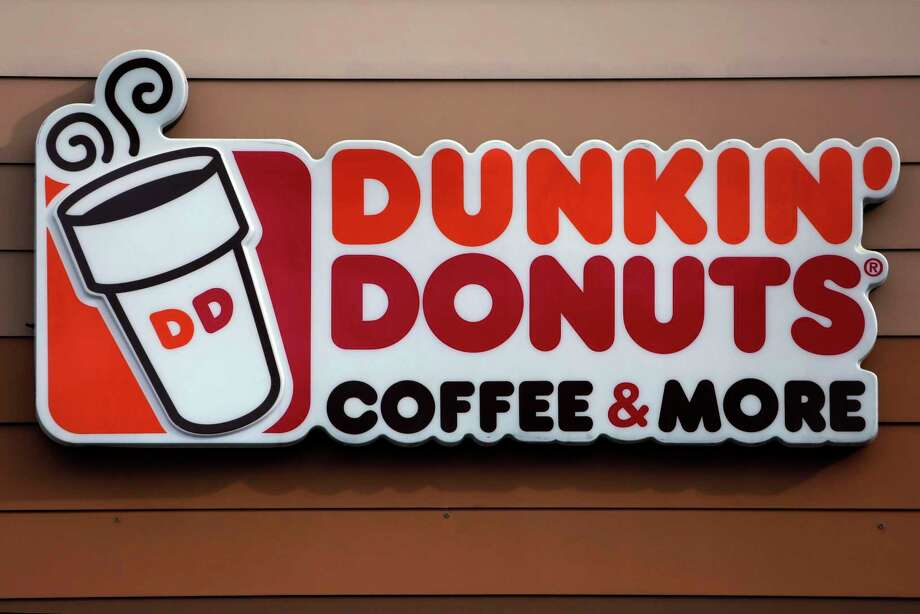 "The Dunkin' coffee chain says customers will have to do without a ""double cup"" for their iced drinks. (AP Photo/Gene J. Puskar, File) Photo: Gene J. Puskar / Associated Press / Copyright 2018 The Associated Press. All rights reserved."