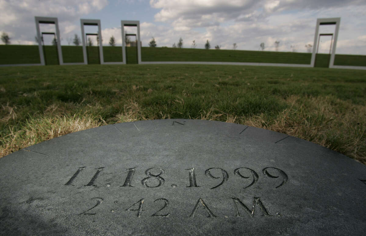 The spot where the center pole of the Texas A&M University bonfire which collapsed 20 years ago Monday is marked with the time and date of the collapse shown on the Texas A&M campus in College Station. The bonfire, which was under construction, collapsed Nov. 18, 1999, killing 11 students and a recent graduate.
