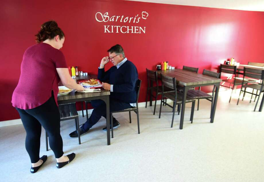Clinton, Connecticut - Thursday, October 24, 2019: Tiffany Sartori, owner of Sartori's Kitchen in Clinton, left, serves lunch to customer Bobby Kaplan of Clinton. Photo: Peter Hvizdak / Hearst Connecticut Media / New Haven Register