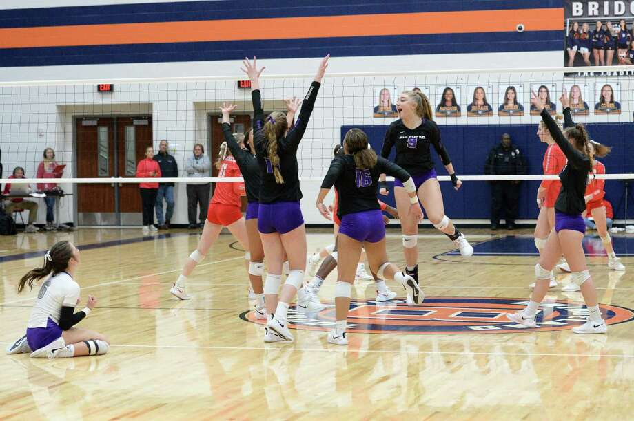 The Fulshear Chargers celebrate their 3-0 victory over the Bellville Brahamanettes in a Class 4A Region IV Quarterfinal volleyball playoff match on Tuesday, November 12, 2019 at Bridgeland HS, Cypress, TX. Photo: Craig Moseley, Staff / Staff Photographer / ©2019 Houston Chronicle