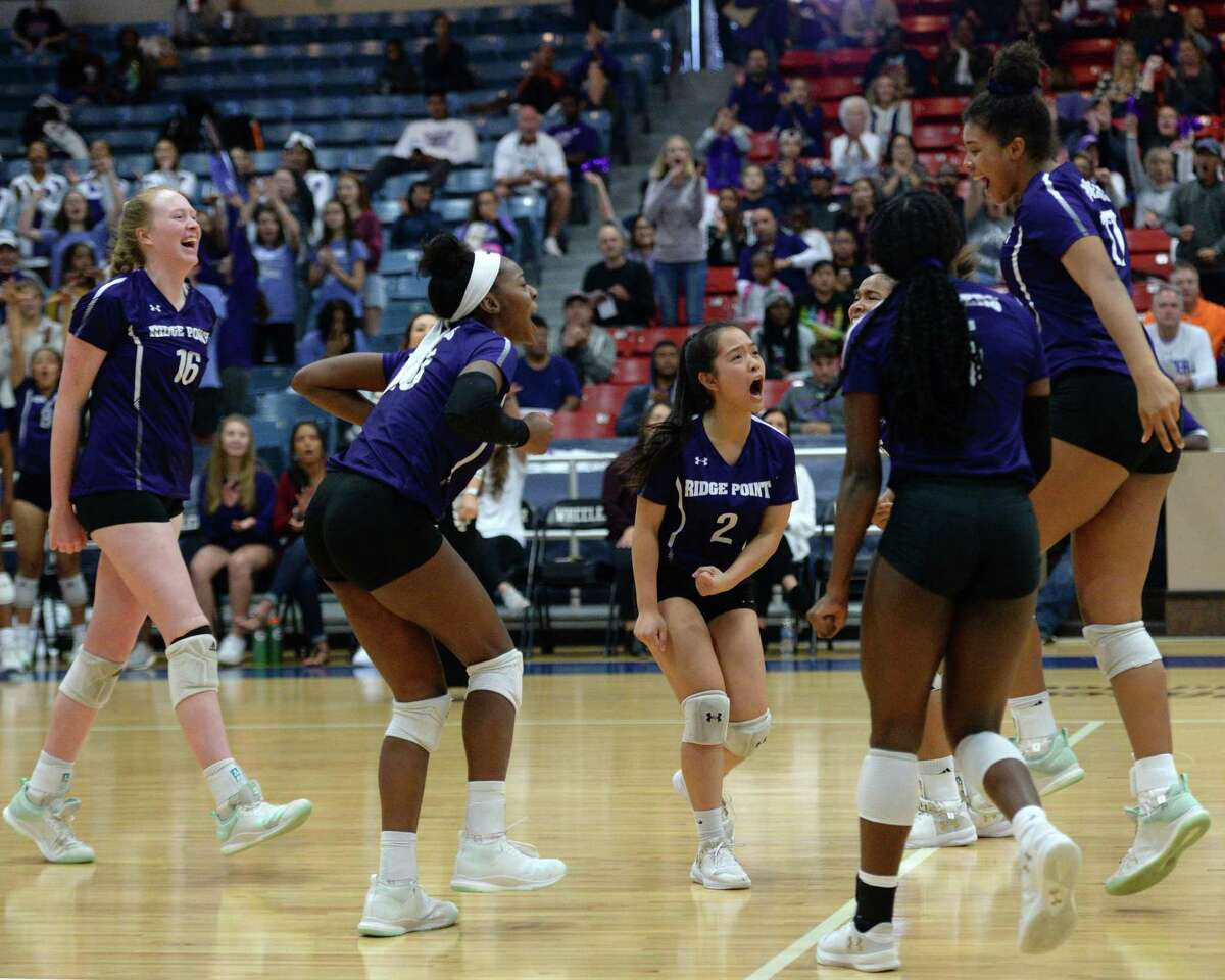The Ridge Point Panthers celebrate a point during the first set of the Region III-6A Final volleyball match with the Cy-Fair Bobcats on Saturday, November 16, 2019 at Wheeler Fieldhouse, Sugar Land, TX.
