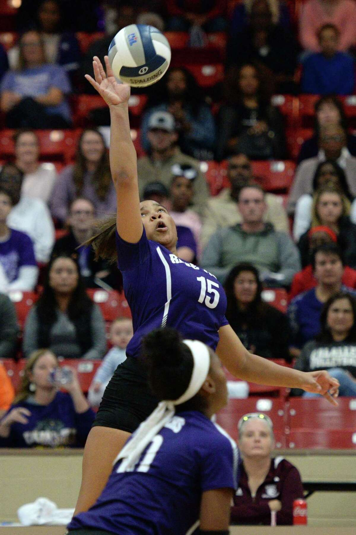 Lindsey Ogle (15) of Ridge Point hits a shot during the first set of the Region III-6A Final volleyball match between the Ridge Point Panthers and the Cy-Fair Bobcats on Saturday, November 16, 2019 at Wheeler Fieldhouse, Sugar Land, TX.