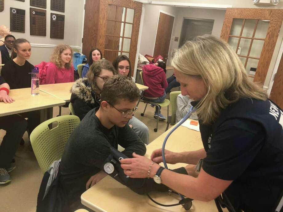 New Canaan YMCA (YSN) Teen Scene participants learn about emergency medical services while visiting New Canaan Emergency Medical Services on Nov. 7, 2019. Photo: Contributed Photo