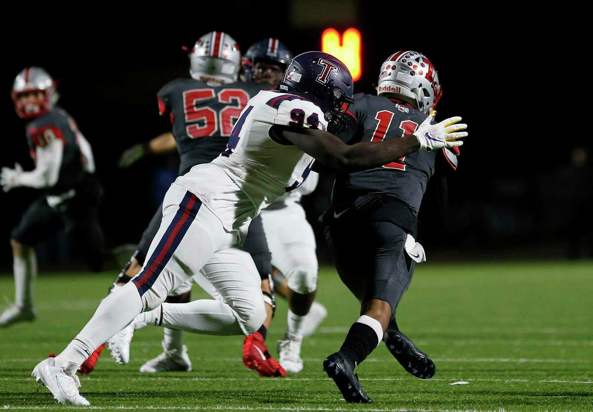 Travis Tigers Eric Rodriguez (11) is sacked by Tompkins Falcons defensive end Tunmise Adeleye (94) during the first half of the high school football playoff game between the Tompkins Falcons and the Travis Tigers at Mercer Stadium in Sugar Land, TX on Thursday, November 14, 2019. The Falcons lead the Tigers 21-14 at halftime.