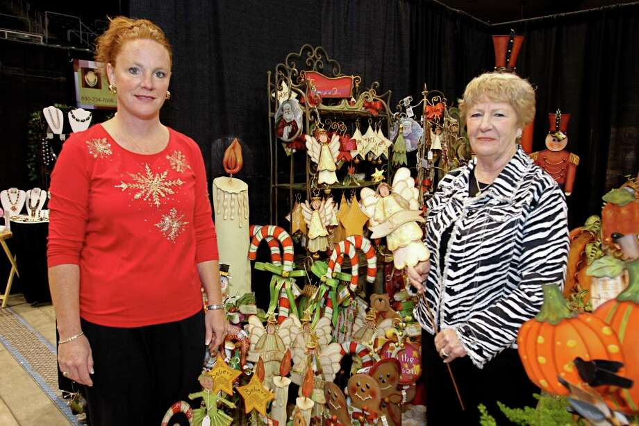 Home for the Holidays Gift Market will be at the Merrell Center, 6301 S. Stadium Lane, in Katy, Nov. 22-24. Visit https://homefortheholidaysgiftmarket .com/ for information. Manning a booth at an earlier Home for the Holidays gift show are, from left, Kim Savage of Sugar Land with her mother, Judy Cox of Magnolia. Photo: Suzanne Rehak, Freelance / For The Chronicle / Freelance