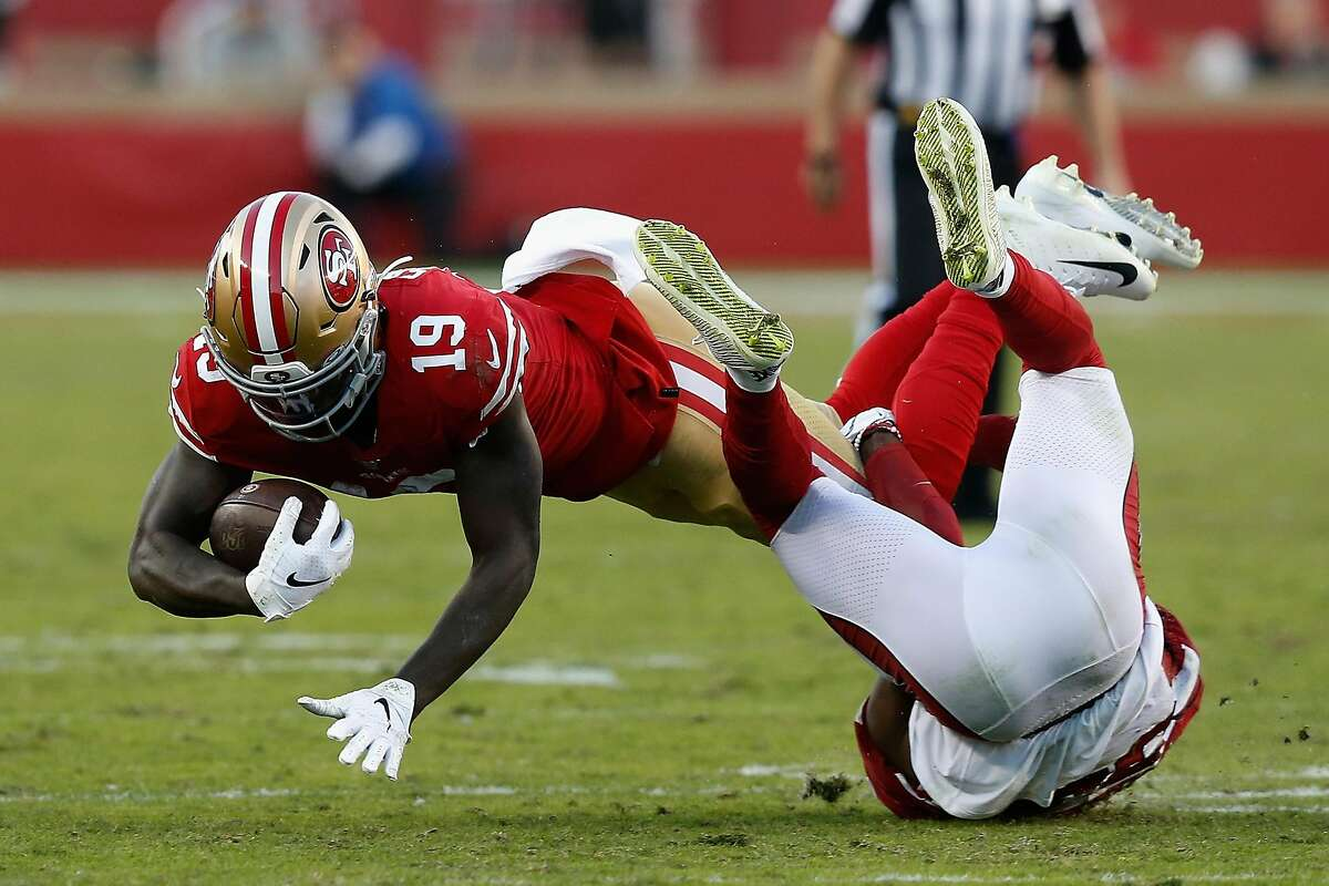 SANTA CLARA, CALIFORNIA - NOVEMBER 17: Wide receiver Deebo Samuel #19 of the San Francisco 49ers dives with the football after a reception against safety Jalen Thompson #34 of the Arizona Cardinals during the first half of the NFL game at Levi's Stadium on November 17, 2019 in Santa Clara, California. (Photo by Lachlan Cunningham/Getty Images)