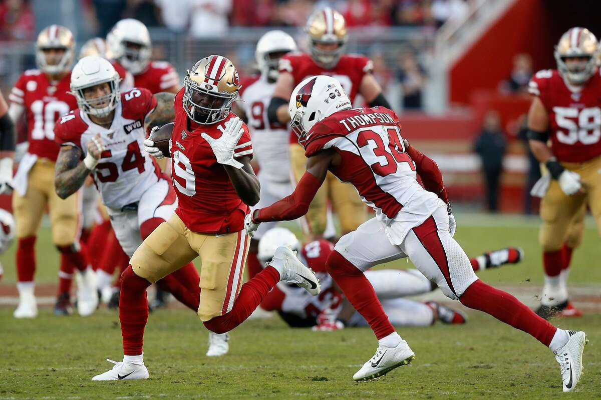 SANTA CLARA, CALIFORNIA - NOVEMBER 17: Wide receiver Deebo Samuel #19 of the San Francisco 49ers carries the football after a reception against safety Jalen Thompson #34 of the Arizona Cardinals during the first half of the NFL game at Levi's Stadium on November 17, 2019 in Santa Clara, California. (Photo by Lachlan Cunningham/Getty Images)
