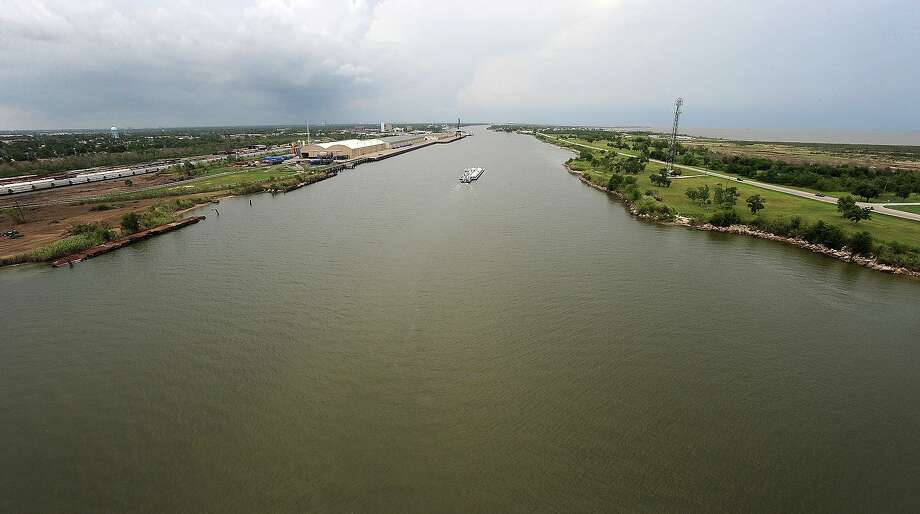 A barge travels along the Sabine-Neches Waterway near the Martin Luther King Bridge on Sunday. The Jefferson County Navigation District, which operates the waterway will observes its centennial on July 29. Guiseppe Barranco/The Enterprise Photo: Guiseppe Barranco / Guiseppe Barranco/ / Beaumont