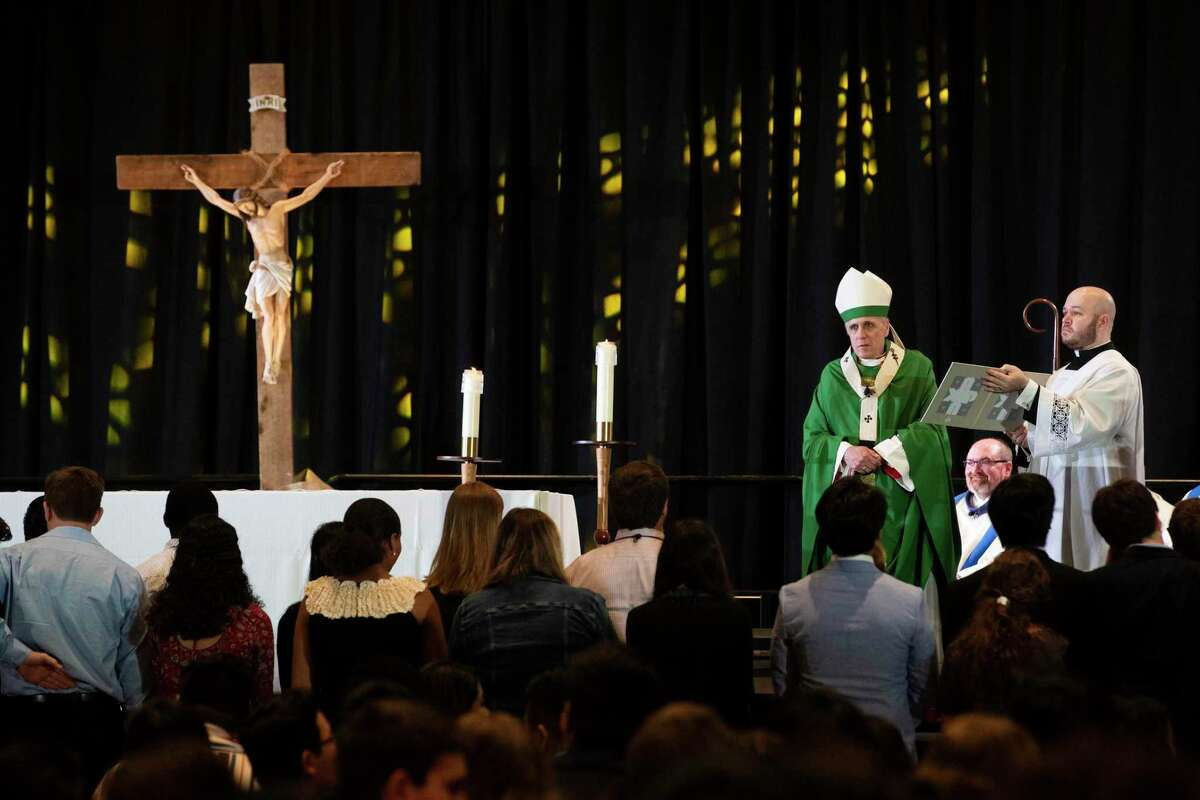 In this July 28, 2019 photo, Archbishop of Galveston-Houston Daniel DiNardo acknowledges the Archdiocese Youth Council during the Archdiocesan Youth Conference Sunday Mass in Houston. The Archdiocese of Galveston-Houston wants to become a foster care provider in Texas, but only if the Catholic organization is exempt from a federal rule meant to protect LGBT people from discrimination.